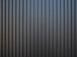 奈良の香芝市の株式会社ヨネヤの外壁塗装と屋根塗装の金属サイディングの画像
